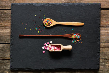 sprinkle: Sugar sprinkle dots on slate background