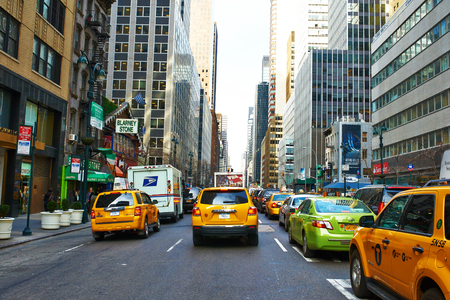 taxi famous building: NEW YORK CITY - MARCH 28: Yellow taxi at street,  March 28 2014 in New York, USA Editorial