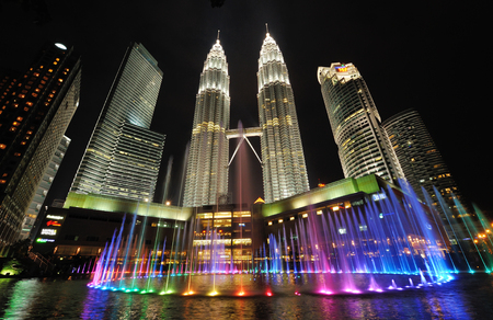 KUALA LUMPUR, MALAYSIA - AUGUST 31: Petronas Twin Towers at night on August 31, 2012 in Kuala Lumpur. Petronas Twin Towers  were the tallest buildings (452 m) in the world from 1998 to 2004.