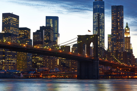 lower manhattan: Brooklyn Bridge with lower Manhattan skyline in New York City at evening Stock Photo
