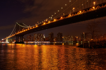 ny: Manhattan Bridge and skyline view from Brooklyn in New York City at night
