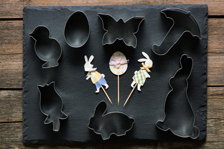 wall decor: Easter cookie cutters on slate