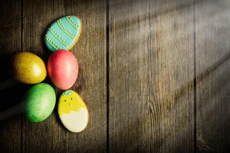 easter cookie: Easter homemade gingerbread cookie and eggs over wooden table