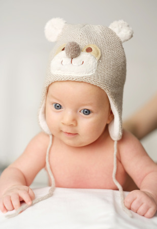 two months: Two months old newborn baby in funny hat Stock Photo