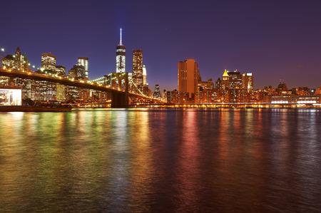 lower manhattan: Brooklyn Bridge with lower Manhattan skyline in New York City at night