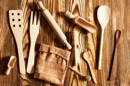 rustic kitchen: Wooden utensils on rustic background