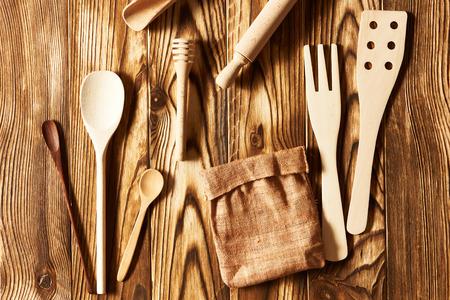 grunge cutlery: Wooden utensils on rustic background