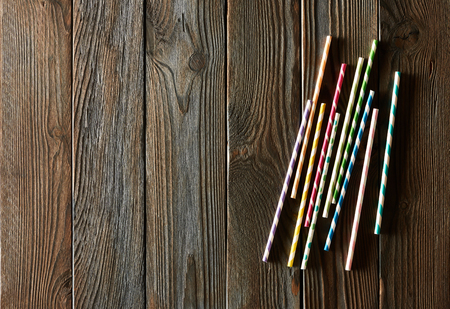 straws: Drinking straws on wooden background