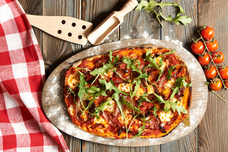 home made: Home made pizza on wooden rustic table