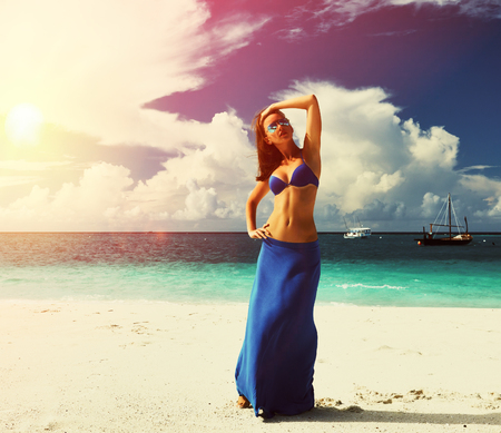 blue sea: Woman in skirt at tropical beach Stock Photo