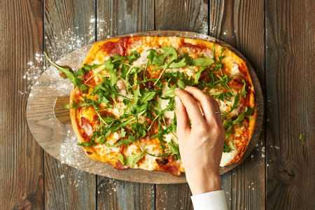 preparation: Home made pizza on wooden rustic table