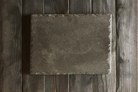 blank slate: Empty slate plate over black wooden background