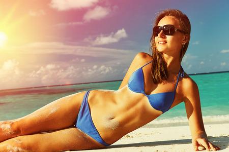 girls in bikini: Woman in bikini at tropical beach Stock Photo