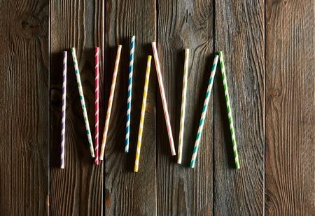 rough: Drinking straws on wooden background