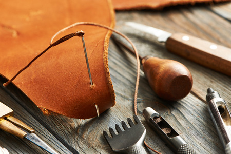 leather background: Leather crafting DIY tools still life