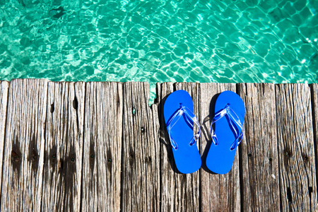 wooden shoes: Slippers at jetty by the sea