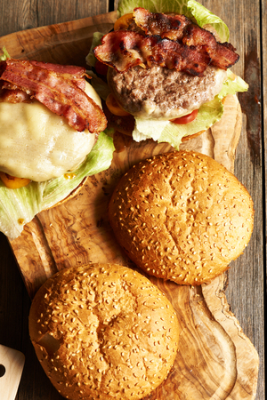 home made: Home made cheeseburgers on rustic wooden table