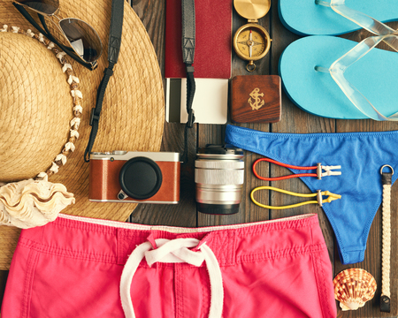 old items: Travel and beach items flat lay still life Stock Photo