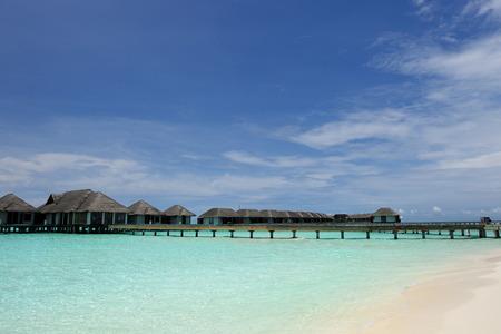 destination scenics: Beautiful beach with water bungalows at Maldives Stock Photo