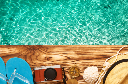 old items: Travel and beach items at jetty