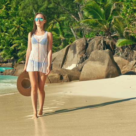 pareo: Woman with sarong on beach Anse Intendance at Seychelles, Mahe Stock Photo
