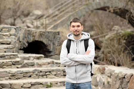 geghard: Man with backpack traveling in Armenia