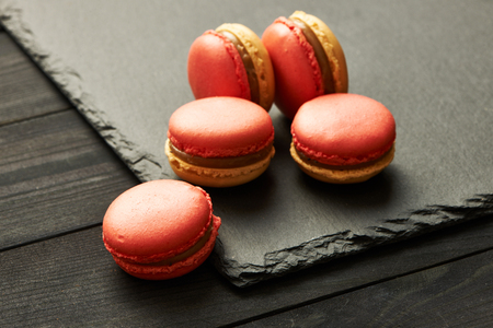 black stone: French delicious dessert macaroons on table