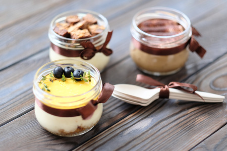 chocolate cakes: Assorted jar cakes on wooden table