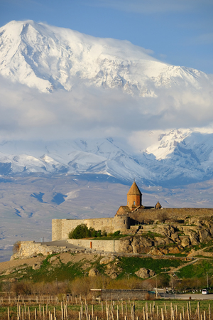 monastery nature: Ancient monastery Khor Virap in Armenia with Ararat mountain at background. Was founded in years 642-1662. Stock Photo