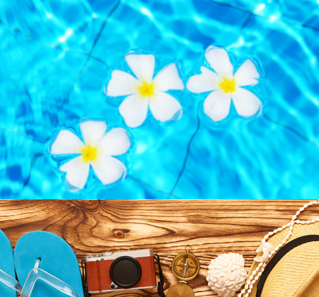 old items: Travel and beach items at pool Stock Photo