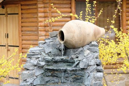 garden fountain: Decorative garden waterfall made with stone jar