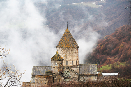 tatev: Ancient monastery Tatev covered with clouds in the mountains of Armenia. Was founded in year 906.