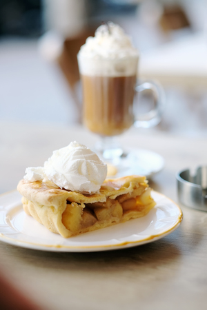 cream pie: Latte with whipped cream and apple pie in outdoor restaurant
