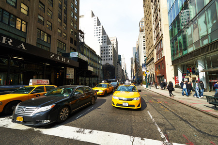 taxi famous building: NEW YORK CITY - MARCH 27: Yellow taxi at street,  March 27 2014 in New York, USA Editorial