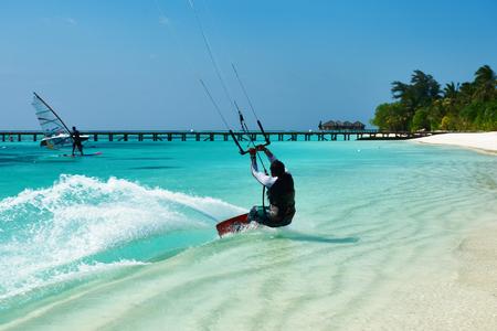 kite surfing: SOUTH ARI ATOLL, MALDIVES � DECEMBER 12 2013: Man kite surfing in waves