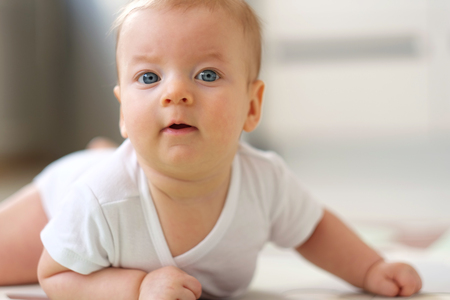baby crawling: Four months old baby crawling on floor