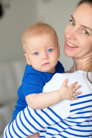 six months: Six months old baby boy with his mother