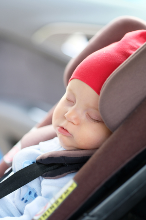 Six Months Old Baby Sleeping In Car Seat Stock Photo