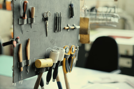 crafting: Leather crafting tools in workshop Stock Photo