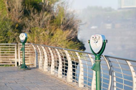 niagara falls city: Tourist binoculars at american side of Niagara Falls, New York, USA