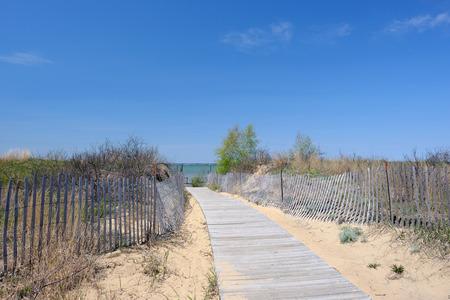 Beach with wooden fence at Lake Huron, Michigan, USA Stock Photo