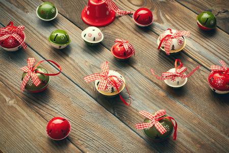 jingle bells: Christmas jingle bells decoration on wooden background Stock Photo