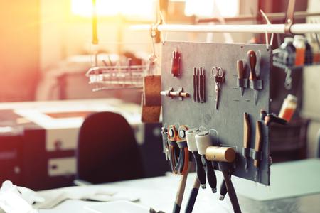 Leather crafting tools in workshop Standard-Bild