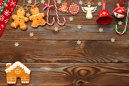 homemade: Christmas homemade gingerbread cookies and handmade decoration on wooden background