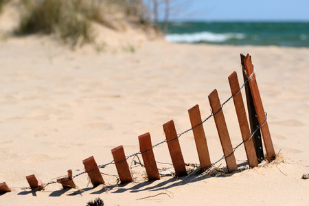 lake beach: Beach with wooden fence at Lake Huron, Michigan, USA Stock Photo