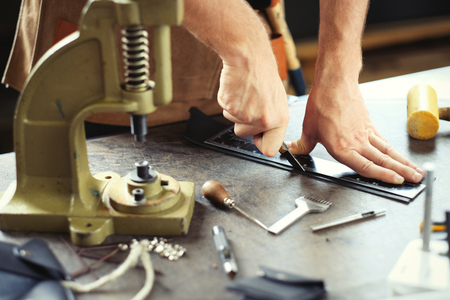 craft product: Leather craft workshop owner at his work place