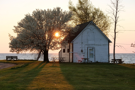 cottage: Sunrise at Pointe aux Barques, Lake Huron, Michigan, USA Editorial