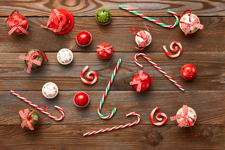 holiday tradition: Christmas jingle bells decoration on wooden background Stock Photo