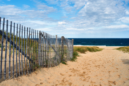 sandy beach: Path way to the beach at Cape Cod, Massachusetts, USA. Stock Photo