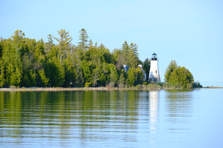 Old Presque Isle Lighthouse, built in 1840, Lake Huron, Michigan, USA Stock Photo
